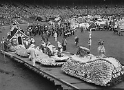 """Y-540612-078. """"Winner of sweepstakes in commercial division was Snow White and Seven Dwarfs entry of Meier & Frank Co., shown in stadium"""" caption published  Rose Festival, Grand Floral Parade. June 12, 1954."""