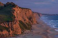 Evening light over coastal cliffs at San Gregorio State Beach, San Mateo County coast, California