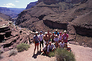 Group shot of people on rafting trip down Colorado River, Grand Canyon National Park, Arizona...Subject photograph(s) are copyright Edward McCain. All rights are reserved except those specifically granted by Edward McCain in writing prior to publication...McCain Photography.211 S 4th Avenue.Tucson, AZ 85701-2103.(520) 623-1998.mobile: (520) 990-0999.fax: (520) 623-1190.http://www.mccainphoto.com.edward@mccainphoto.com.