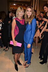 Left to right, PANDORA DELEVINGNE and her daughter CARA DELEVINGNE at a Dinner to celebrate the launch of the Mulberry Cara Delevingne Collection held at Claridge's, Brook Street, London on 16th February 2014.