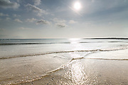 Gentle waves crossing at Broad Beach, as they bounce of the nearby reef at Rhosneigr, Anglesey, Wales.