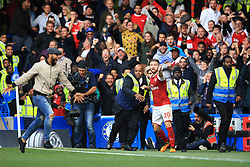17 September 2017 -  Premier League - Chelsea v Arsenal - Shkodran Mustafi of Arsenal celebrates a disallowed goal as a fan runs onto the pitch - Photo: Marc Atkins/Offside
