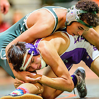 Wingate Bear J.J. Long  left, battles Miyamura Patriot Isaiah Sanchez at Wingate High School Wednesday.