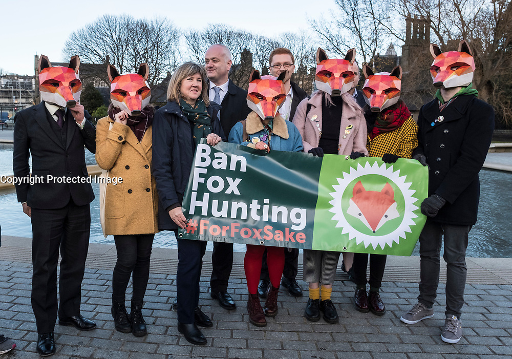 Edinburgh, Scotland, United Kingdom. 7 December, 2017. Scottish Green MSP Alison Johnston (3L) joined with animal welfare campaigners at the Scottish Parliament at Holyrood to support her member's bill to ban fox hunting in Scotland.