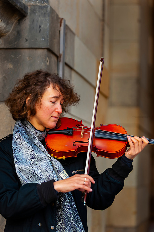 Female musician playing the violin, Zwinger, Dresden, Saxony, Germany