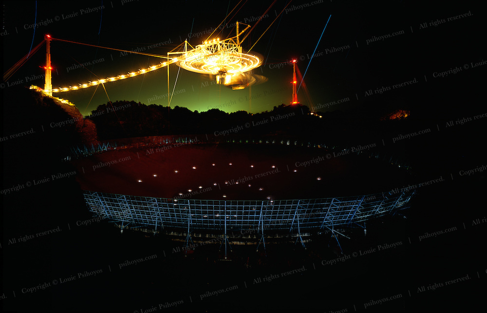 Arecibo Observatory is the largest single radio telescope dish in the world.  Located in the jungles of northern Puerto Rico and operated by Cornell University it collects and sends out radio waves.