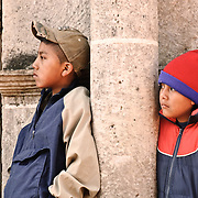Two young boys watch the performance as part of the Convite de 12 Dicembre in Chichicastengo.  Chichicastenango is an indigenous Maya town in the Guatemalan highlands about 90 miles northwest of Guatemala City and at an elevation of nearly 6,500 feet. It is most famous for its markets on Sundays and Thursdays.