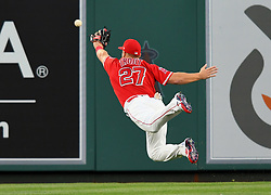 April 18, 2018 - Anaheim, CA, U.S. - ANAHEIM, CA - APRIL 18: Los Angeles Angels of Anaheim center fielder Mike Trout (27) makes a diving attempt at a ball hit by Red Sox designated hitter Hanley Ramirez (13) in the first inning of a game played on April 18, 2018 at Angel Stadium of Anaheim in Anaheim, CA. (Photo by John Cordes/Icon Sportswire) (Credit Image: © John Cordes/Icon SMI via ZUMA Press)