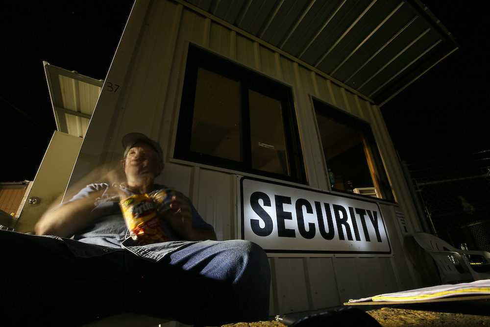 Danny Prewitt, general foreman of the welding department, takes a break while guarding the Signal International shipyard overnight in Orange, Texas, Wednesday September 17, 2008.  Thick mud covered the area, washed in by Hurricane Ike.  At the time there was no word yet on when operations would be back to normal at the shipyard.