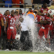 Louisville head coach Charlie Strong gets the Gatorade dumped on him by Cardinals defensive end Lorenzo Mauldin (94)during the NCAA Football Russell Athletic Bowl football game between the Louisville Cardinals and the Miami Hurricanes, at the Florida Citrus Bowl on Saturday, December 28, 2013 in Orlando, Florida. Louisville won the game by a score of 36-9. (AP Photo/Alex Menendez)