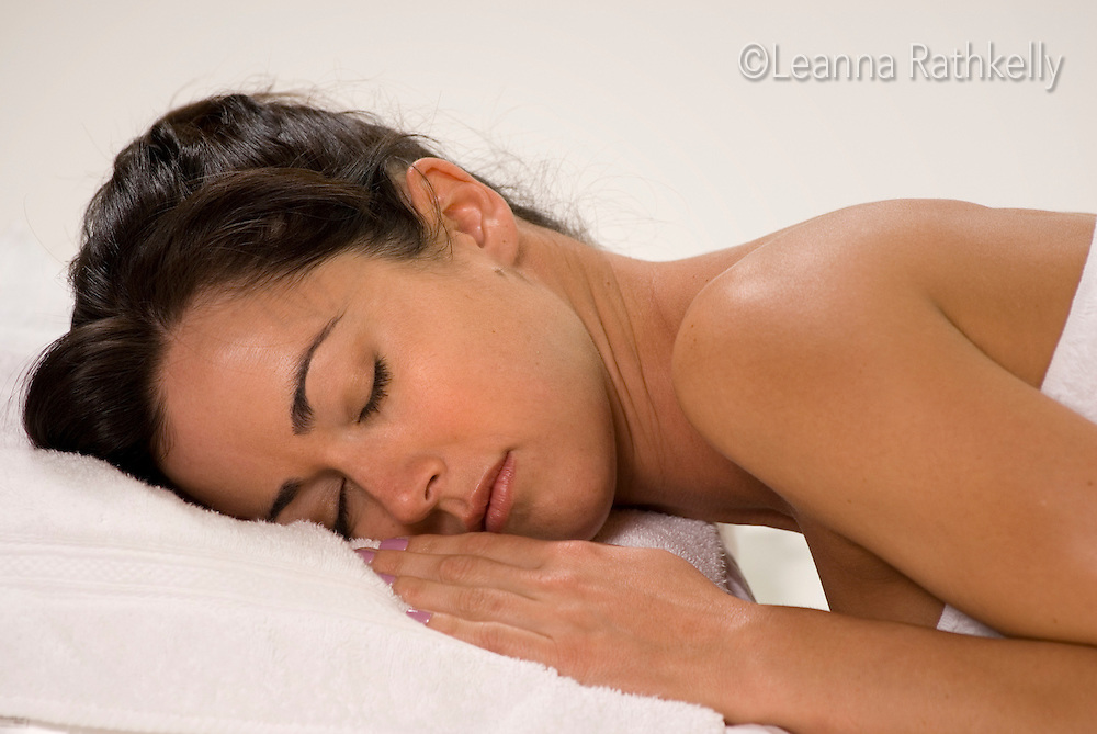 A soothing massage is enjoyed by a relaxed woman.