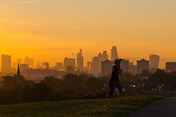 Primrose Hill, London, October 4th 2016. A runner makes her way up Primrose Hill as dawn breaks across London.