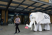 """Stop HS2 campaigners use a HS2 white elephant holding a £170bn sign during outreach activities on the occasion of a HS2 Routewide Roadshow at Kings Cross Square on 5th August 2021 in London, United Kingdom. There have been increasing doubts regarding the viability of the northern section of the HS2 high-speed rail link since a recent report published by the Infrastructure and Projects Authority gave Phase 2b the lowest red rating, indicating that successful delivery of the scheme """"appears to be unachievable""""."""