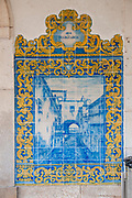 Painted blue ceramic tile panes on the walls of old Obidos Railway Station, Portugal