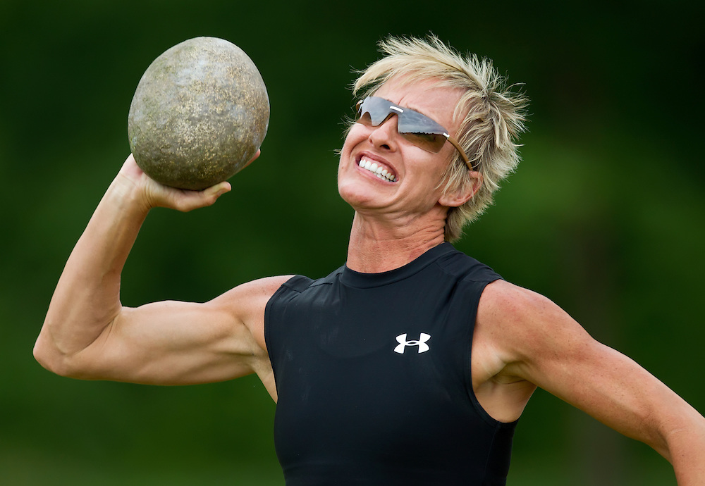 Paula Funderburke of Tampa, Florida reached back to throw a 15.5 lb. stone during competiton in the Braemer women's put competition of Master's Womens division of the Scottish Highland Games at E.H. Young Riverfront Park in Riverside, Mo. on June 12, 2011. Funderburke, 42, had a best throw of 18 feet, 3/4 inches to place second in her division. The Braemer put is thrown with one hand from a stationary position while the athlete is not allowed to move his feet forward until after the stone leaves her hand.