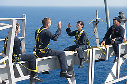MEDITERRANEAN SEA (May 3, 2017) Lt. Cmdr. Ben McCarty, second from left, reenlists Information Systems Technician 2nd Class Nikki Duffy on the yardarm of the Arleigh Burke-class guided-missile destroyer USS Ross (DDG 71). Ross, forward-deployed to Rota, Spain, is conducting naval operations in the U.S. 6th Fleet area of operations in support of U.S. national security interests in Europe and Africa. (U.S. Navy photo by Mass Communication Specialist 3rd Class Robert S. Price/Released)170503-N-FQ994-198 <br /> Join the conversation:<br /> http://www.navy.mil/viewGallery.asp<br /> http://www.facebook.com/USNavy<br /> http://www.twitter.com/USNavy<br /> http://navylive.dodlive.mil<br /> http://pinterest.com<br /> https://plus.google.com