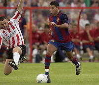 12 August 2003; Ricardo Quaresma, Barcelona, in action against Derry City's Michael Holt. Friendly game, Derry City v Barcelona, Brandywell, Derry. Picture credit; David Maher / SPORTSFILE *EDI*