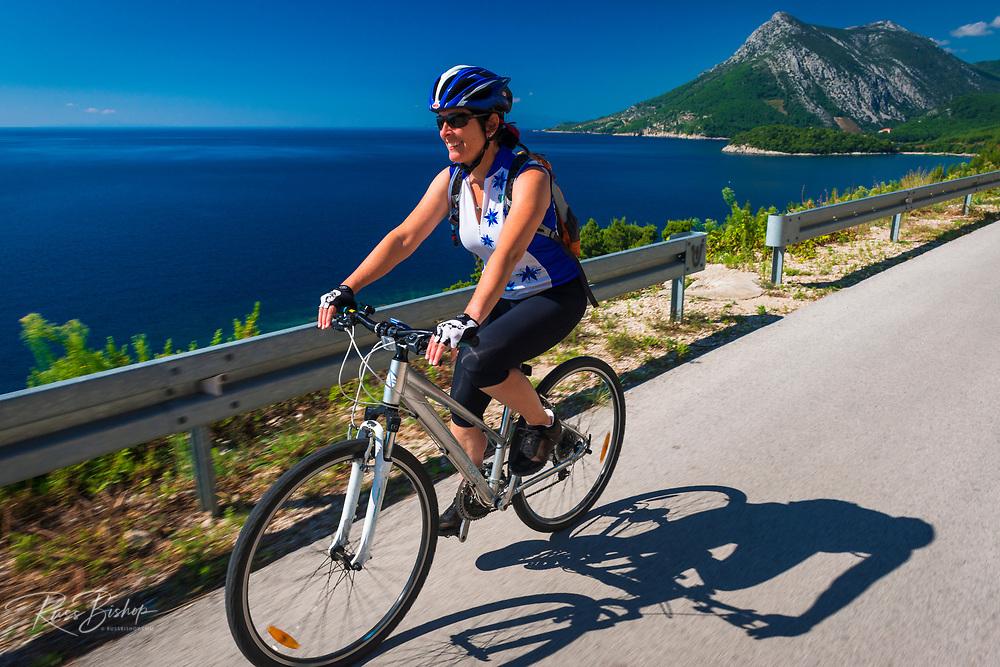 Cycling above the Adriatic Sea nearTrstenik, Peljesac Peninsula, Dalmatia, Croatia