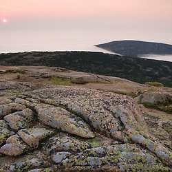 Morning fog fills the valleys below Cadillac Mountain in Maine's Acadia National Park.