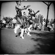 Majorettes stepping out during a parade in downtown Hattiesburg, Mississippi.
