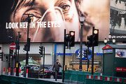 A government NHS (National Heath Service) ad displays the face of a Covid patient, urging Londoners to stay at home and not to take risks or bend the rules during the third lockdown of the Coronavirus pandemic, at Piccadilly Circus in the capital's West End, on 3rd February 2021, in London, England.