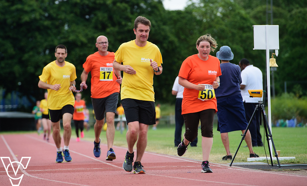 Event: 5000 meter relay<br /> Competitors, from left: David Beynon and Ruth Stacey<br /> <br /> Metro Blind Sport's 42nd Athletics Open, held at Mile End Stadium, Tower Hamlets, London.<br /> <br /> Picture: Chris Vaughan Photography for Metro Blind Sports<br /> Date: June 16, 2018