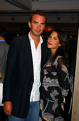 FRITZ VON WESTENHOLTZ and CAROLINE SIEBER at a party to celebrate 'Made in Italy at Harrods' - a celebration of Italian fashion food and wine, design and interiors, art and photography, cinema and music, beauty and glamour.  The party was held in the Georgian Restaurant at Harrods, Knightsbridge, London on 9th September 2004.<br />