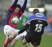 """The Rec"", Bath, West Somerset. Heineken Cup Quarter Final (Sun) 27/01/2002<br /> Bath v LlanelliHeineken Cup Quarter Final Bath Rugby vs Llanelli <br /> Scalets Guy EASTERBY running in to block, Matt Perry's clearance kick <br /> <br /> <br /> [Mandatory Credit Peter SPURRIER/Intersport Images]"