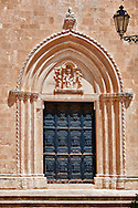 The Italian Gothic ogival main door of the medieval Cathedral of Ostuni built between 1569-1495  .Ostuni, The White Town, Puglia, Italy. .<br /> <br /> Visit our ITALY HISTORIC PLACES PHOTO COLLECTION for more   photos of Italy to download or buy as prints https://funkystock.photoshelter.com/gallery-collection/2b-Pictures-Images-of-Italy-Photos-of-Italian-Historic-Landmark-Sites/C0000qxA2zGFjd_k<br /> .<br /> <br /> Visit our MEDIEVAL PHOTO COLLECTIONS for more   photos  to download or buy as prints https://funkystock.photoshelter.com/gallery-collection/Medieval-Middle-Ages-Historic-Places-Arcaeological-Sites-Pictures-Images-of/C0000B5ZA54_WD0s