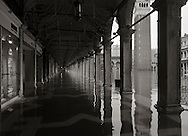 """The porticoes of the Procuratie Vecchie in San Marco square completely flooded by about 50 cms (almost 2 feet) of """"acqua alta"""", the high tide that regularly floods Venice during the winter months. Taken on an early morning at the end of January."""