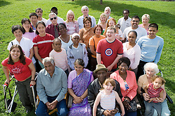 Multiracial group of people including various family members,