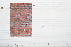 Brickwork frame in a white painted wall