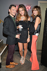 Left to right, MATTHEW WILLIAMSON, LANA GANDOUR and DILA GANDOUR at the Cavan.com Pop-Up sale held at The Belgraves Hotel, 20 Chesham Place, London on 20th May 2014.