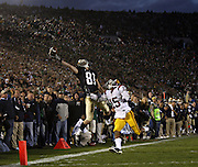 A potential touchdown pass in the last minute of the fourth quarter is just out of the reach of Notre Dame receiver John Goodman (81) while USC's Kevin Thomas (15) defends as USC defeated Notre Dame 34-27 in a college football game Saturday, Oct. 17, 2009 in South Bend, Ind.  (Brian Cassella/Chicago Tribune)