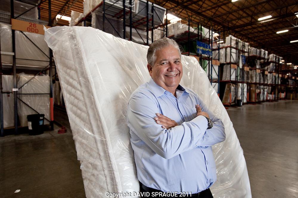 Larry Miller, President of Sit N Sleep in his mattress warehouse in Gardena, CA. September 13,  2011. Photo by David Sprague