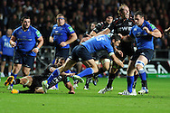 Leinster's Rob Kearney © is ankle tapped by Joe Bearman of the Ospreys. Heineken cup rugby, pool 1 match, Ospreys v Leinster rugby at the Liberty stadium in Swansea on Sat 12th October 2013 pic by Andrew Orchard, Andrew Orchard sports photography,