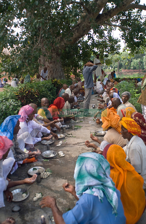 """Sep 15, 2015 - Bodhgaya, Bihar, India - People praying under the bodhi tree where the Buddha reached enlightenment at Mahabodhi Temple, Bodhgaya, Bihar, India, Bodhgaya, Bihar, India. Mahabodhi Temple In Bodhgaya. Mahabodhi Temple of Bodh Gaya, India Bodh Gaya, India is where Siddhartha Gautama attained enlightenment. There are few places on earth that match the peacefulness of its Mahabodhi Temple, which was built at the Bodhi tree where the Buddha sat under around 530 BCE. Visitors to hectic India will be particularly relaxed sitting among countless Buddhist monks who make journeys to India to pay respect to the Buddha and to collect falling leaves from the famous Bodhi tree. If you're lucky, you may be meditating next to the singing Thai monk who visits the temple regularly. He happens to have an affinity for tying Western music to Buddhist philosophy. You will likely hear: """"keep smilin', keep shinin'."""" Knowin' you can always count of me, for sure"""" or """"let it be, let it be. Whisper words of wisdom, let it be."""" The great philosopher will also help you deal with India's stifling heat with his little bottle of Thai Ang Ki, which cools your skin when added to a sprinkling of water. (Credit Image: © Sergi Reboredo/ZUMA Wire/ZUMAPRESS.com)"""