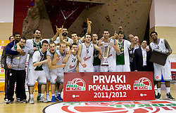 Players of Olimpija celebrate after the basketball match between KK Union Olimpija Ljubljana and KK Krka Novo mesto in Final match of 11th Slovenian Spar Cup 2012, on February 19, 2012 in Sports hall Brezice,  Brezice, Slovenia. Union Olimpija defeated Krka 68-63 and became Slovenian Cup Champion 2012. (Photo By Vid Ponikvar / Sportida.com)