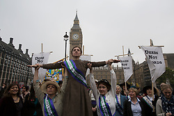 © licensed to London News Pictures. London, UK 24/10/2012. Members of UK Feminista posing outside the Houses of the Parliament as they meet for a mass lobby with Dr Helen Pankhurst, granddaughter of Emmeline Pankhurst and calling on MPs to stop erosion of women's rights and drive forward progress on women's equality. Photo credit: Tolga Akmen/LNP