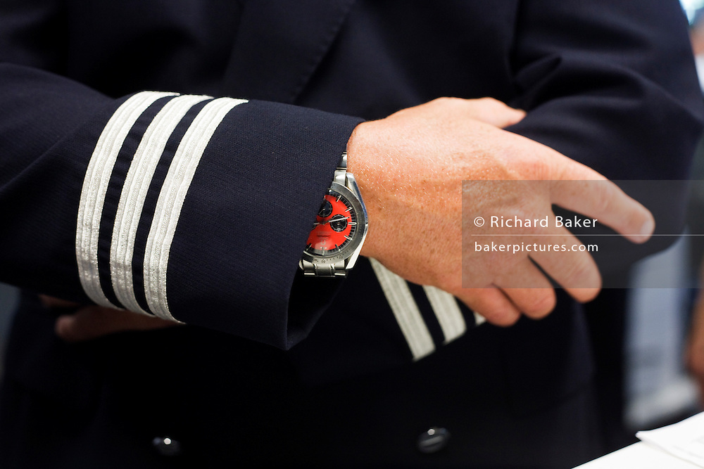 Safe pair of pilot's hands in the British Airways Crew Report Centre at Heathrow Airport's Terminal 5.