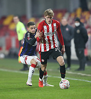 Middlesbrough's Marcus Browne and Brentford's Mads Roerslev<br /> <br /> Photographer Rob Newell/CameraSport<br /> <br /> The Emirates FA Cup Third Round - Brentford v Middlesbrough - Saturday 9th January 2021 - Brentford Community Stadium - Brentford<br />  <br /> World Copyright © 2021 CameraSport. All rights reserved. 43 Linden Ave. Countesthorpe. Leicester. England. LE8 5PG - Tel: +44 (0) 116 277 4147 - admin@camerasport.com - www.camerasport.com