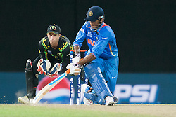 © Licensed to London News Pictures. 28/09/2012. Indian Irfan plays a shot behind himself during the T20 Cricket World cup match between Australia Vs India at the R.Premadasa Cricket Stadium,Colombo. Photo credit : Asanka Brendon Ratnayake/LNP