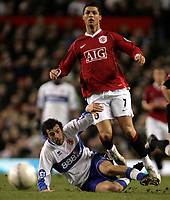 Photo: Paul Thomas.<br /> Manchester United v Middlesbrough. The FA Cup, Quarter Final replay. 19/03/2007.<br /> <br /> Cristiano Ronaldo (R) of Utd battles with Julio Arca.