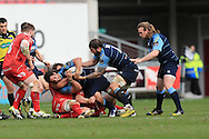 Josh Navidi of Cardiff Blues is tackled.  Guinness Pro12 rugby match, Scarlets  v Cardiff Blues at the Parc y Scarlets in Llanelli, West Wales on Saturday 2nd April 2016.<br /> pic by  Andrew Orchard, Andrew Orchard sports photography.