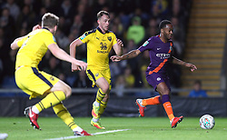 """Manchester City's Raheem Sterling (right) in action during the Carabao Cup third round match at the Kassam Stadium, Oxford. PRESS ASSOCIATION Photo. Picture date: Tuesday September 25, 2018. See PA story SOCCER Oxford. Photo credit should read: Andrew Matthews/PA Wire. RESTRICTIONS: EDITORIAL USE ONLY No use with unauthorised audio, video, data, fixture lists, club/league logos or """"live"""" services. Online in-match use limited to 120 images, no video emulation. No use in betting, games or single club/league/player publications"""