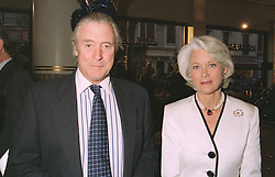 MR TIM POWELL the veteran powerboat driver and MRS VICTOR BARCLAY, widow of Victor Barclay the son of the founder of the Rolls Royce dealership Jack Barclay, at a party in London on April 17th 1997.LXT 32