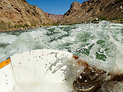 Boating through whitewater. Day 15 of 16 days rafting 226 miles down the Colorado River in Grand Canyon National Park, Arizona, USA.