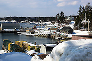 Winter Docks in Port Clyde Maine, lots of snow, cold and sun.