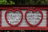 Koinoki Shrine enshrines the God of Love.  Since many young people pray to the God of Love for a good match and so the shrine is a hot spot for finding love in addition to the wedding ceremony business. A heart-shaped Crest of the shrine, paper fortunes, amulets, and wooden plaques all have a heart motif of course  Its enshrined deity is Koinomikoto and is the only shrine in Japan worshipping this particular deity.