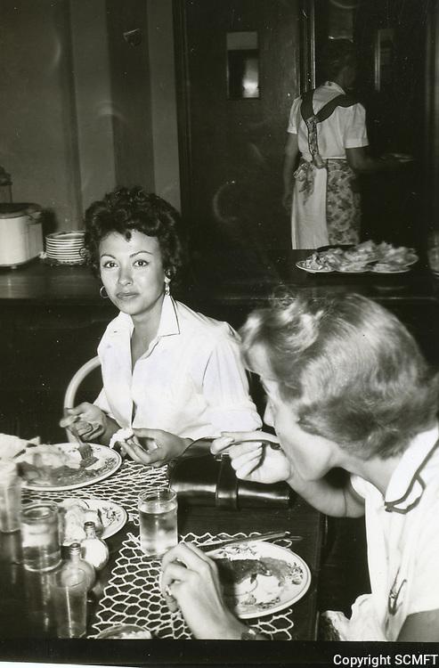1954 Rita Morino eats at the Hollywood Studio Club